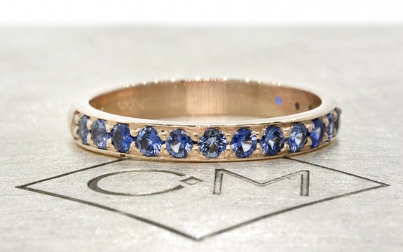Wedding Band with 16 Blue 2mm Sapphires front view on logo
