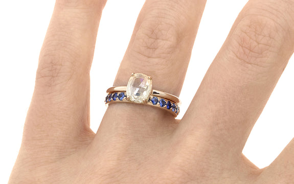Wedding Band with 16 Blue 2mm Sapphires worn with engagement ring