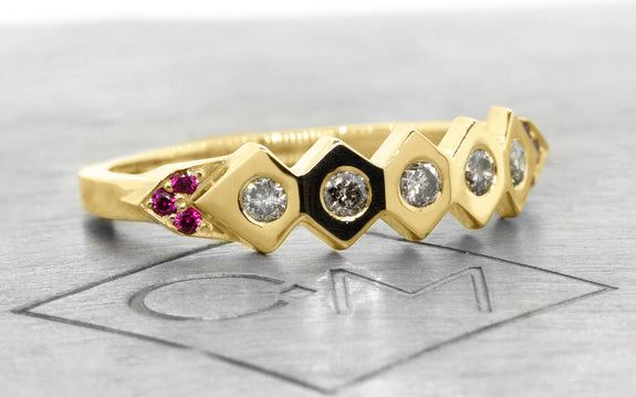 1925 Wedding Band with Gray Diamonds & Rubies in rose gold on logo
