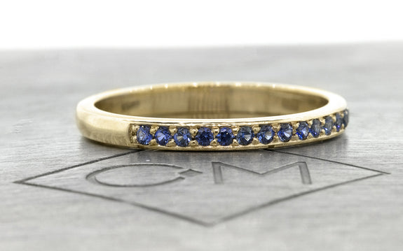 Wedding Band with 16 Blue Sapphires side view on logo