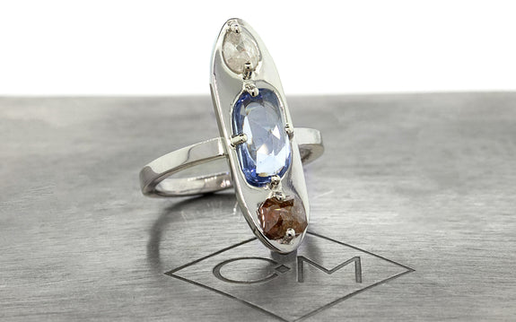 Sapphire & Icy White Diamond Ring front view on logo