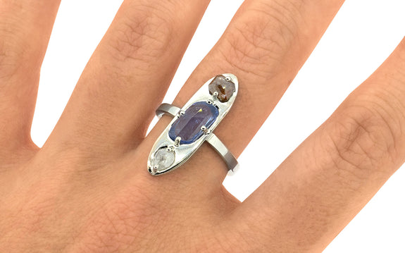 Sapphire & Icy White Diamond Ring side view on logo