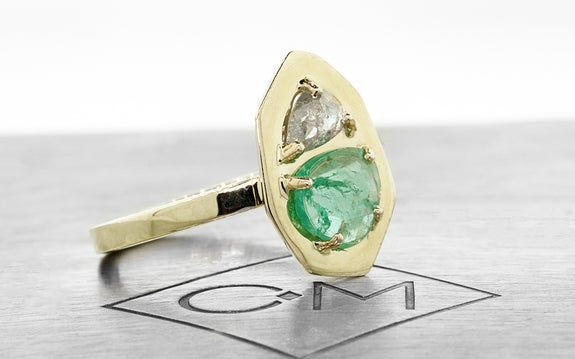 emerald and diamond ring side view