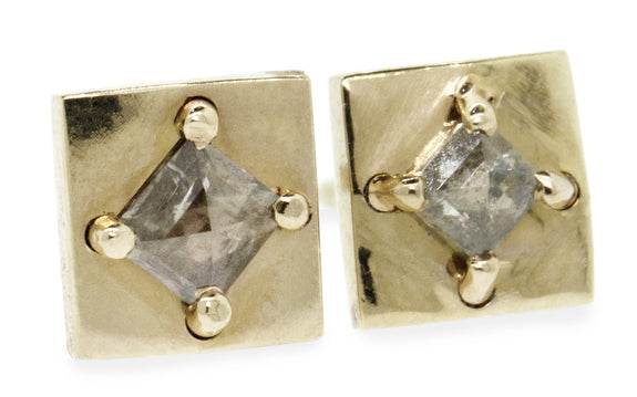Light gray diamond earrings being worn
