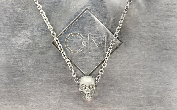 Diamond Skull Necklace back side on logo