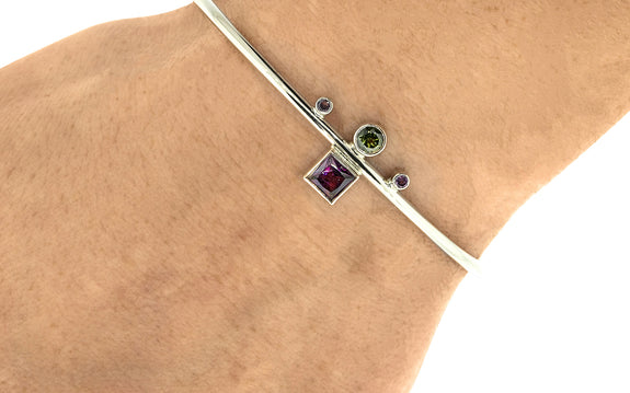 Green and Pink Tourmaline Bracelet side view on logo