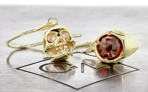 Diamond & Garnet Skull Earrings back view on logo