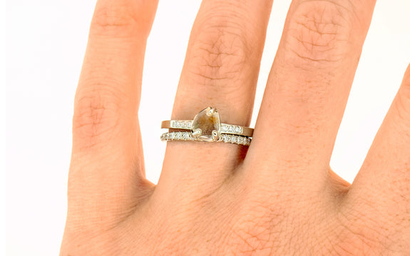 1.23 Carat White/Orange Montana Sapphire Ring on a hand with wedding band