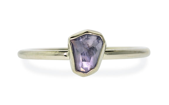 .76 carat hand cut lavender blue Montana sapphire bezel set in white gold front view on white background