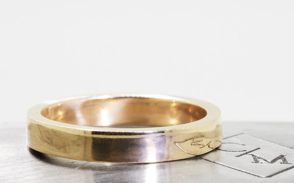 Men's Flat Gold Wedding Band on logo