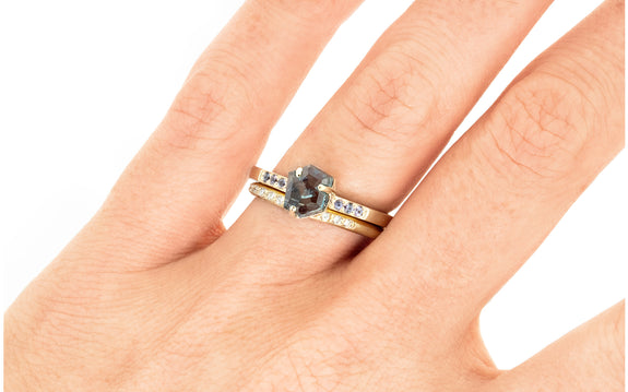 1.37 Carat Hand-Cut Blue Montana Sapphire Ring on a hand with wedding band