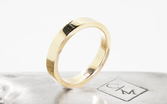 Men's Flat Gold Wedding Band up on its side