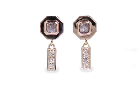 .38ct pink/purple diamond earrings on model