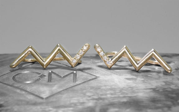 Zig Zag Ear Climbers in Yellow Gold front view on logo