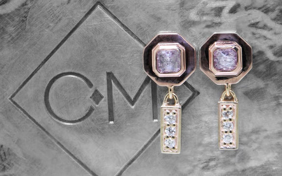 .38ct pink/purple diamond earrings front view
