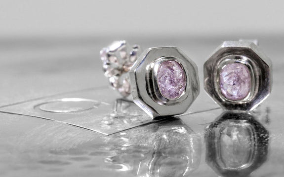 .45 carat pink/purple diamond stud earrings front view by logo