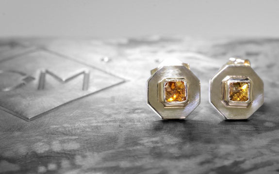 .44 carat cognac diamond stud earrings front view by logo