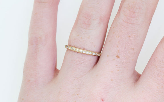 16 diamond wedding band worn by model