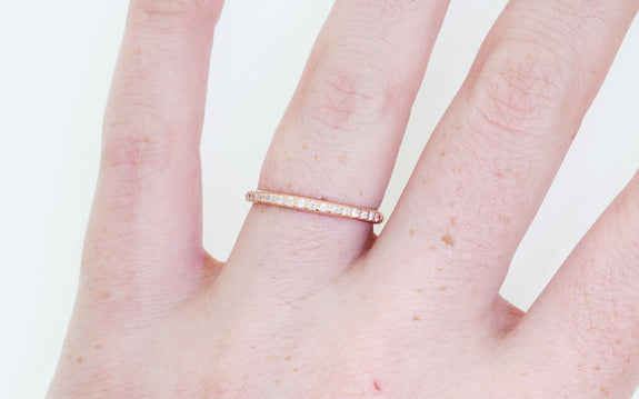 16 diamond wedding band in rose gold on model