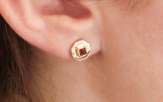 .44 carat cognac diamond stud earrings being worn