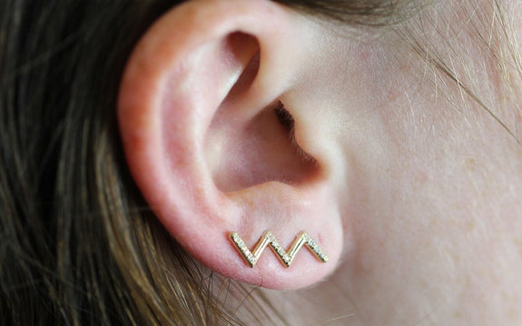 Diamond Zig Zag Ring in Yellow Gold on ear