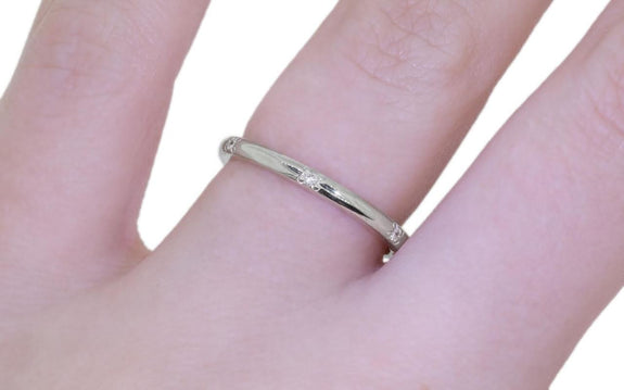 Wedding Band with 6 White Diamonds worn by model