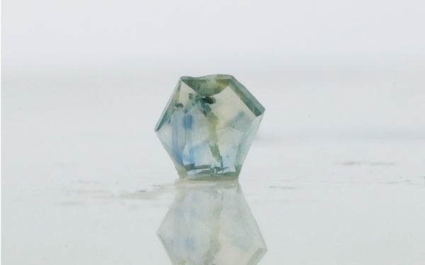 .92 carat hand cut tropical blue green Montana Sapphire on white background