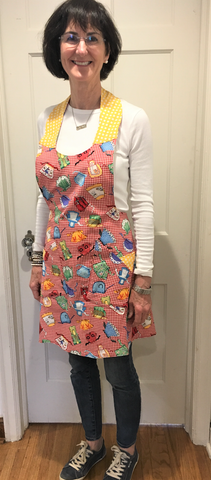 Bib Apron in red and yellow reversible cotton prints from Art 2 Heart Gift Shop in Hamel MN