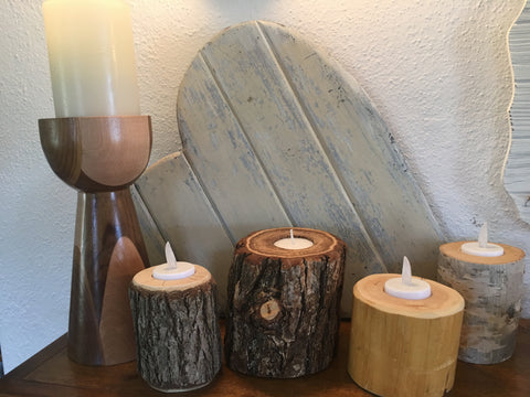 Hand-carved wood candle holders at Art 2 Heart