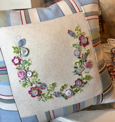 Hand-embroidered flower swath on a toss pillow at Art 2 Heart Gift Shop in Hamel MN