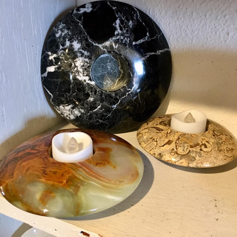 Disc-style votive holders from Art 2 Heart Gift Shop in Hamel MN