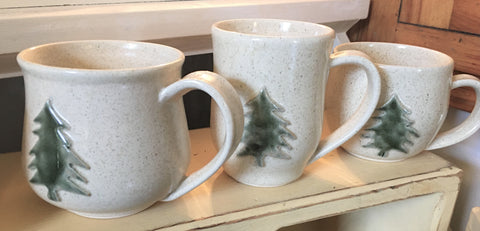 Handmade pottery coffee mugs with pine tree motif from Art 2 Heart Gift Shop in Hamel MN