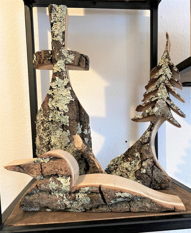 hand-carved trees and loon available at Art 2 Heart Gift Shop in Hamel MN