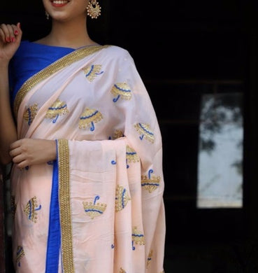 Attractive Peach And Blue Georgette Embroidery Saree With Blouse