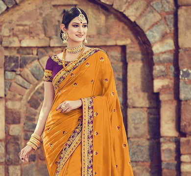 Faciable Orange & Purple Rimjim Heavy Embroidered Work With Edged Saree