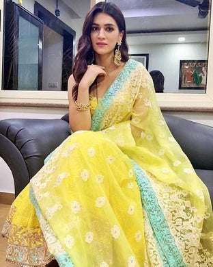 Kriti Sanon Exclusive Designer Georgette Salwar Suit In Yellow Color
