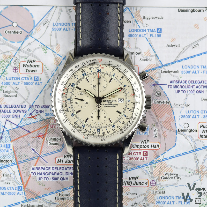 2010 Breitling Navitimer World Chronograph Ref. A2432212/G571 - Silver Dial - Full set box and papers - Vintage Watch Specialist