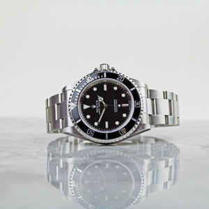 2005 Rolex Oyster Submariner Non-Date Ref.14060 with box and papers - Vintage Watch Specialist