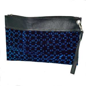 Marie clutch in black and blue mudcloth with leather trim