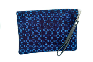 Marie clutch in black and navy mudcloth with leather trim