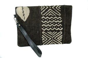 Marie clutch in black fold over mudcloth with leather trim