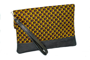 Marie fold over clutch in Red and Yellow wax print with leather trim