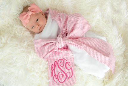 Baby swaddle blanket with bow