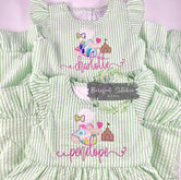 Bonnet baby on green seersucker dress