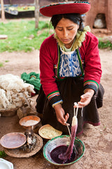 Peruvian woman dying wool in the Sacred Valley of the Incas