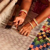 Indian woman weaving textiles.