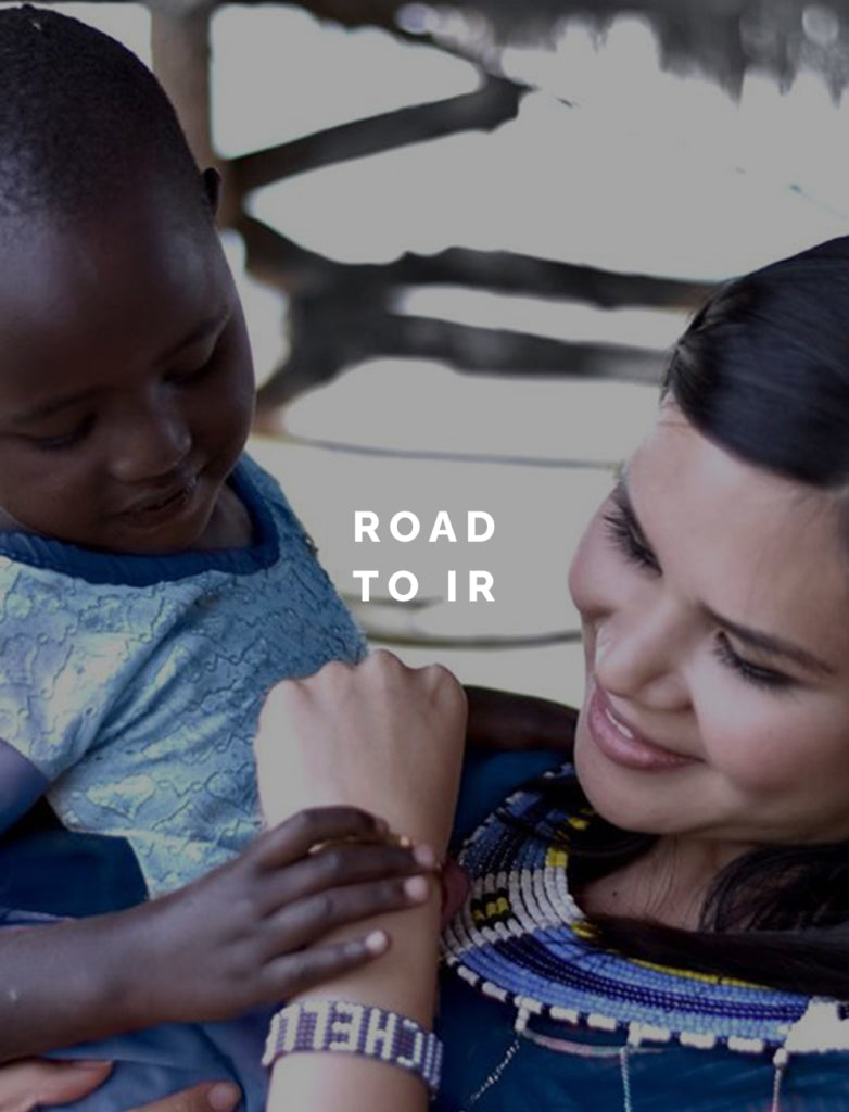 A woman holding a child with text reading Road To Ir