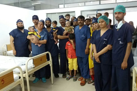 The team and patients in Lahore