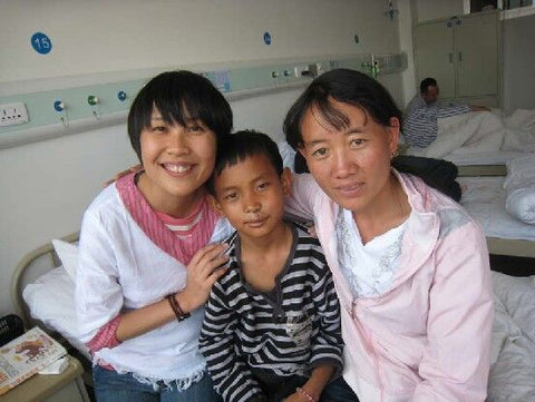 A Changde patient shows off his new smile.