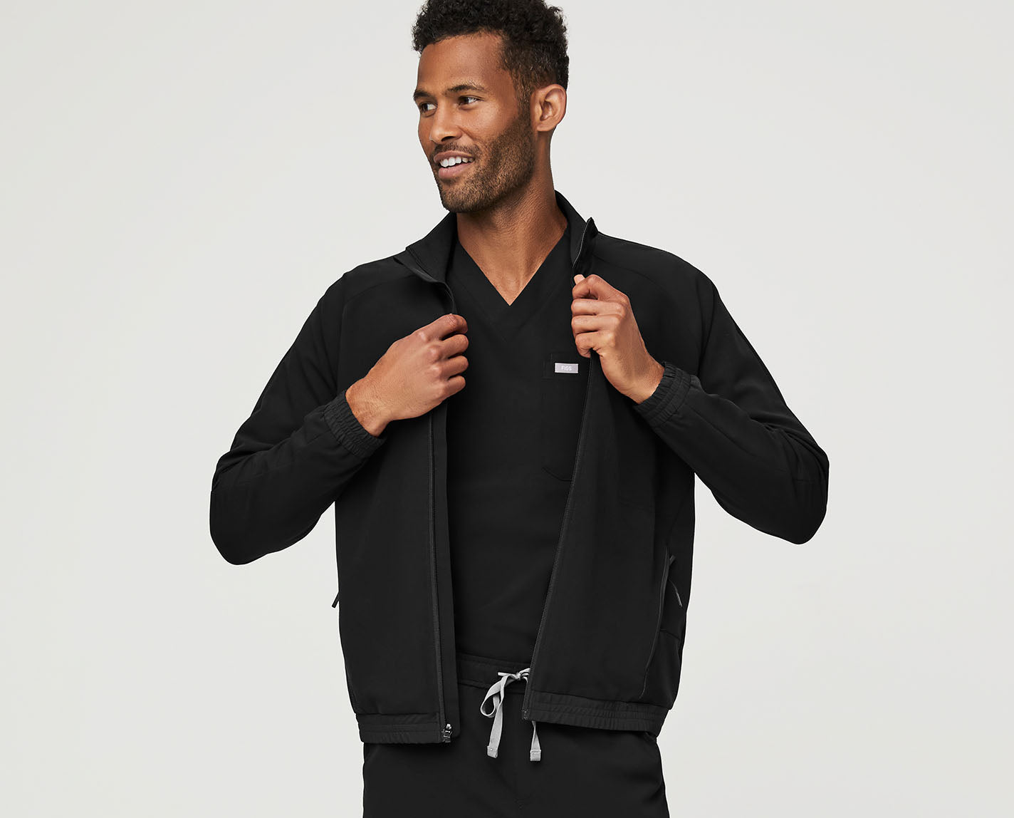 Cool on every layer. The Cobaki Scrub Jacket features a back yoke vent for airflow and ventilation, a mesh lining for breathability and temperature regulation, TPU trim and detailing, five functional pockets and both our proprietary FIONx fabric and eco-friendly FIONlite fabric. Like, the coolest.